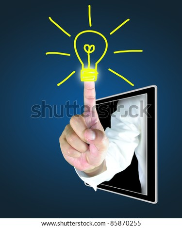male hand from tablet touch a light bulb - stock photo