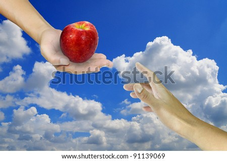 Male hand give the world to other male hand - stock photo