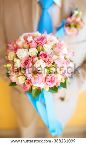 male hand giving bouquet of white roses - stock photo