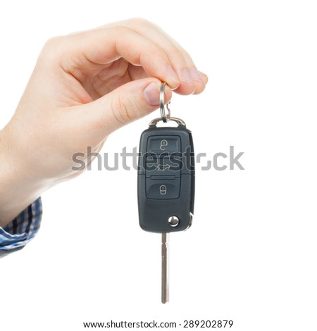 Male hand giving car keys - close up shot