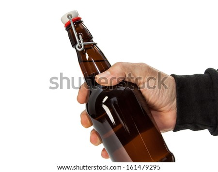 male hand holding a bottle - stock photo