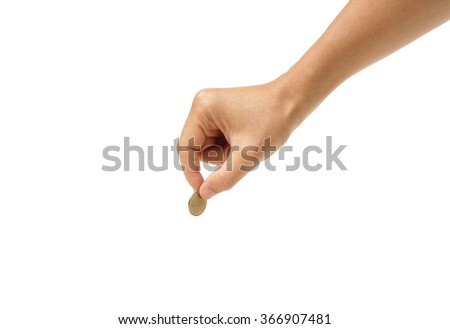 male hand holding a golden coin                                - stock photo