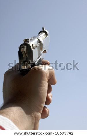 Male hand holding a gun - stock photo