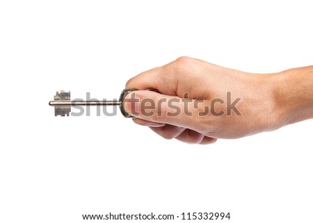 Male hand holding a key to the house, image is taken over a white background.