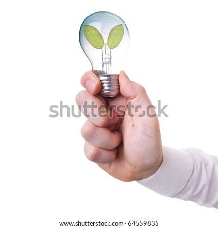Male hand holding a light bulb with fresh green leaves inside (energy and ecology concept and more) - stock photo