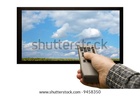 male hand holding a remote control aimed at a flat screen tv - stock photo