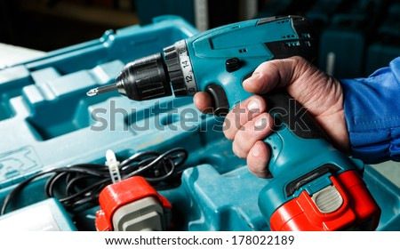 Male hand holding a screwdriver - stock photo