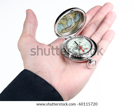 Male hand holding a silver vintage-style compass, isolated on a white background - stock photo