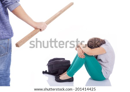Male hand holding a wooden stick to beaten on a little girl, isolated on a white background - stock photo