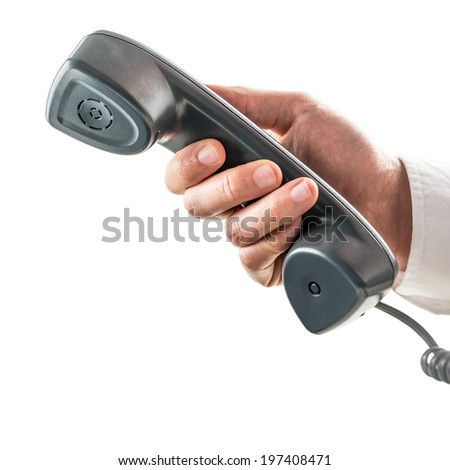 Male hand holding an old-fashioned black telephone receiver handset in a communication concept isolated on white. - stock photo