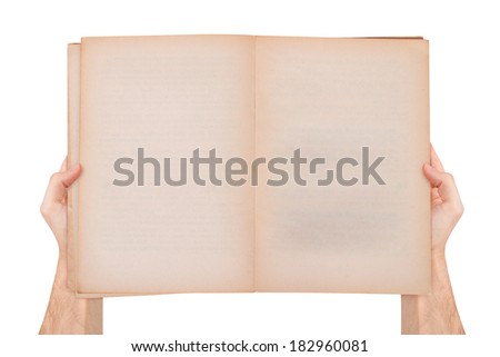 Male hand holding blank empty open and old style book with copy space for your message, top view, isolated on white background. - stock photo