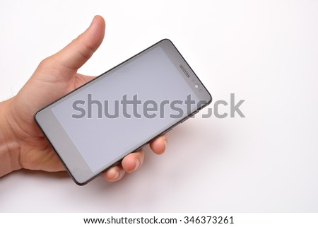 Male hand holding blank mobile smartphone with clipping path for the screen - stock photo