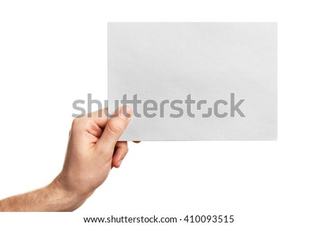 Male hand holding clean sheet of paper, isolated on white - stock photo
