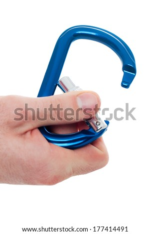 Male hand holding climbing carabin, isolated on white background. Focus on carabin - stock photo