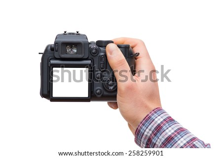 Male hand holding DSLR camera isolated on white - In this photo the logos, brand, or anything that can bring to a particular object has been deleted to be 100% commercial. - stock photo