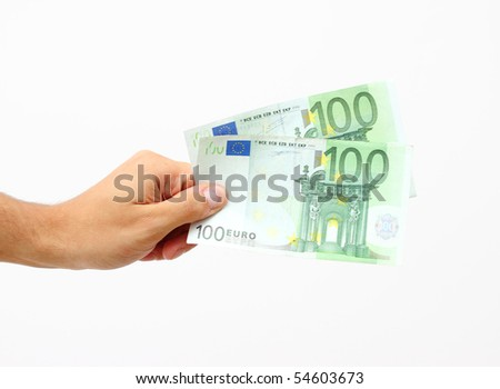 male hand holding 100 Euro banknotes - stock photo