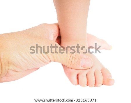 Male hand holding firmly around a foot of toddler isolated on white - stock photo
