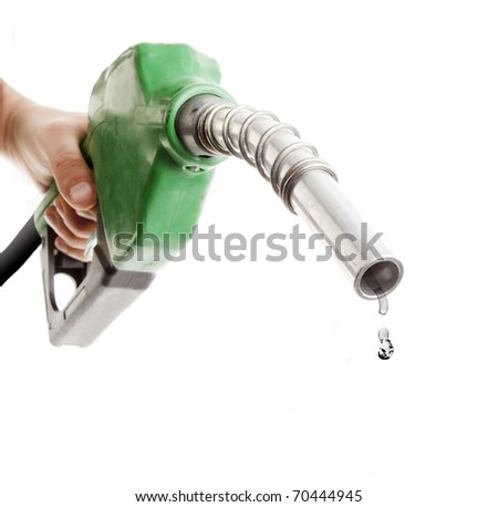 Male hand holding gas pump isolated on white with one last drop of fossil fuel - stock photo