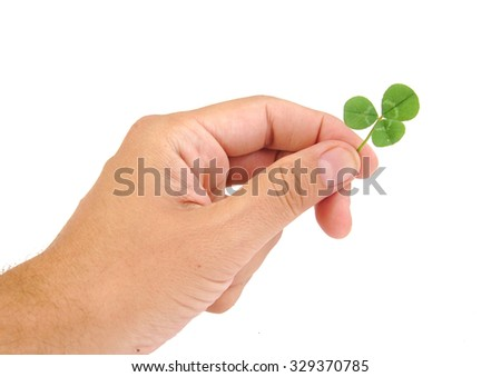 Male hand holding green clover leaf, isolated on white background - stock photo