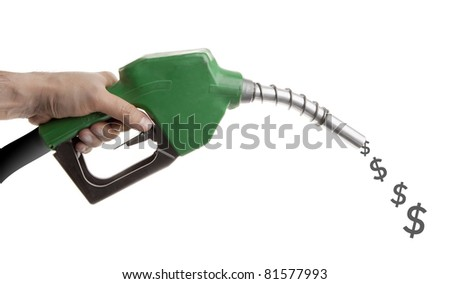 Male hand holding green gas pump with dollar signs spilling isolated on white - stock photo
