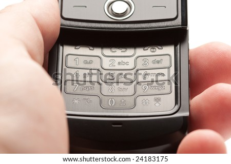 Male Hand Holding Grey Cell Phone Image - stock photo