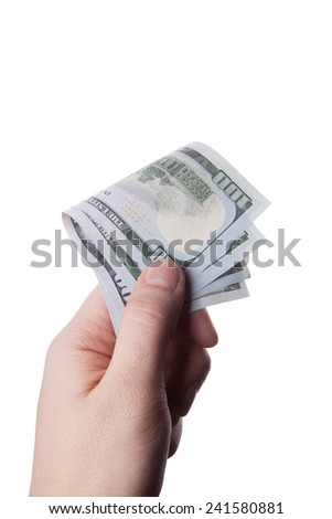 male hand holding hundred dollar banknotes on white background - stock photo