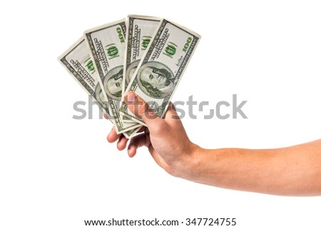 Male hand holding money cash isolated on a white background - stock photo