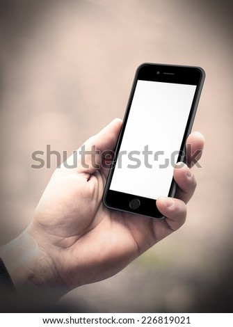 Male hand holding smartphone, iphon 6 style - stock photo