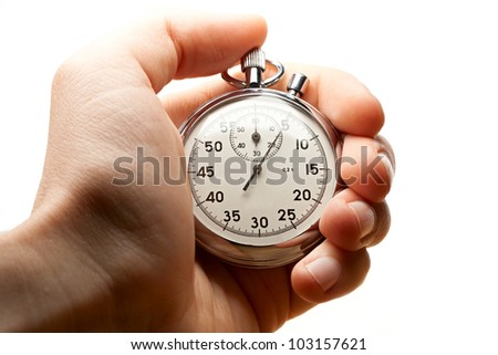 Male hand holding stopwatch - stock photo