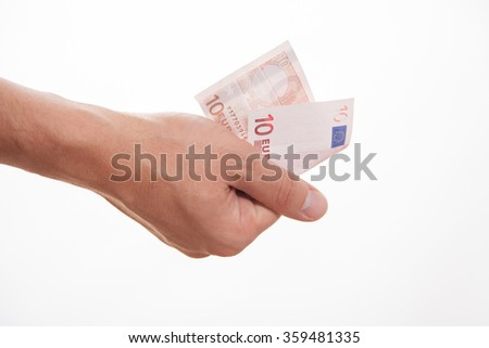 Male hand holding ten euro, white background