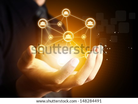 Male hand holding virtual icon of social network - stock photo