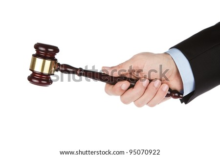 Male hand holding wooden gavel isolated on white background - stock photo