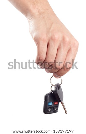 Male hand holds a car key and an alarm control isolated on white background