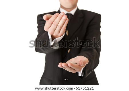 Male hand in suit holding coins on white isolated background - stock photo