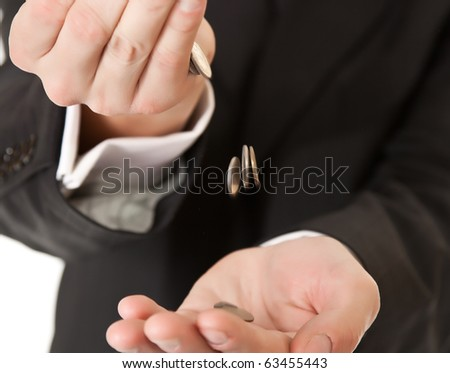 Male hand in suit holding coins on white isolated background