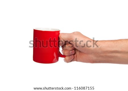 Male hand is holding a red cup isolated on a white background - stock photo
