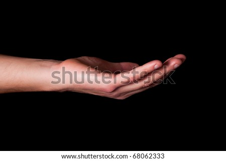 Male hand on black background