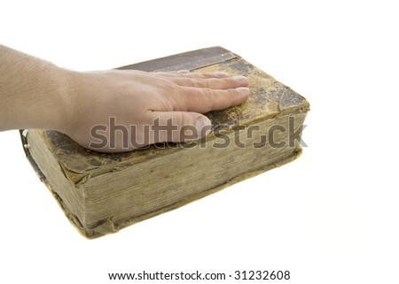 Male hand on the vintage bible - stock photo