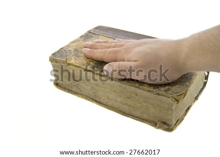 Male hand on the vintage bible isolated over white - stock photo