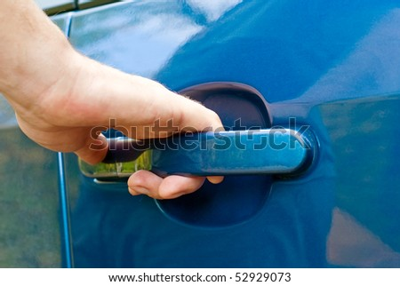 male hand opening car door - stock photo
