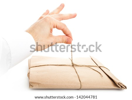 Male hand opening envelope tied with a rope isolated on white background - stock photo