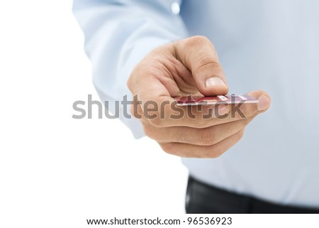 Male hand paying with the credit card isolated on white background - stock photo