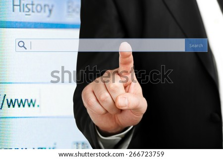 male hand pressing an internet search bar, internet and business concept - stock photo