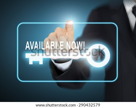 male hand pressing available now key button over blue abstract background - stock photo