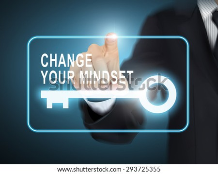 male hand pressing change your mindset key button over blue abstract background - stock photo