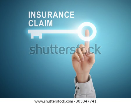 male hand pressing insurance claim key button over blue abstract background  - stock photo