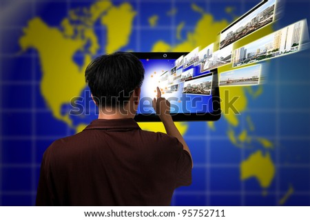 Male Hand push on Touch screen tablet PC as Media technology concept - stock photo