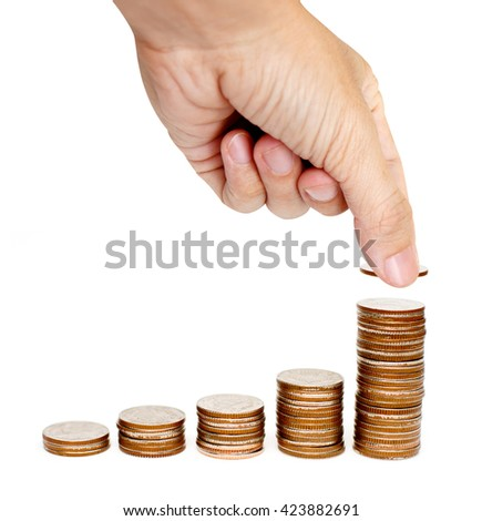 male hand putting coin on a stack of rising coins isolated on white background - stock photo