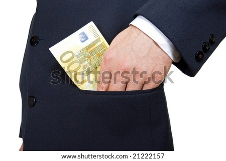 Male hand putting money in the pocket - stock photo