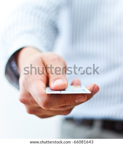 Male hand showing credit card - stock photo